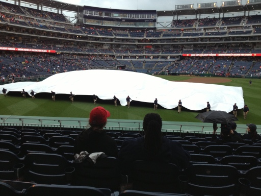 Rolling the tarp back signals the end of the 57-minute delay is near!