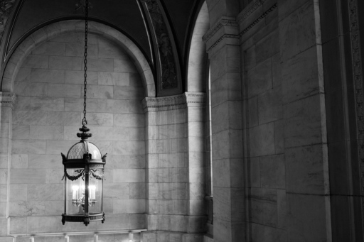 Beautiful light fixtures hang throughout the library.