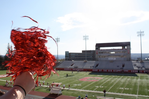 Amanda shakes her pom-pom at Cornell's Schoellkopf Field. Go Big Red!