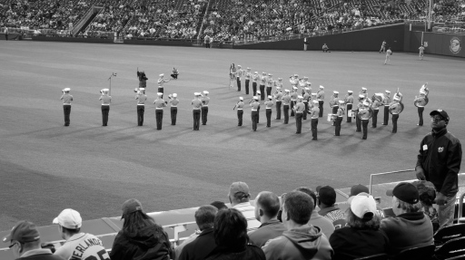 The Marine Corps Band performs the national anthem.