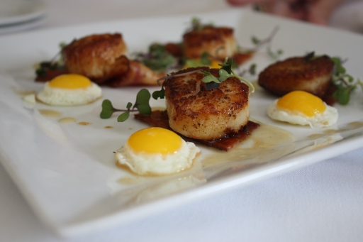 Jumbo scallops with smoked bacon and fried quail egg ... an eggscellent seafood-breakfast combo.