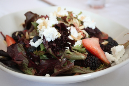 This salad looks appetizing doesn't it? It's topped with fresh berries, goat cheese and toasted almonds.