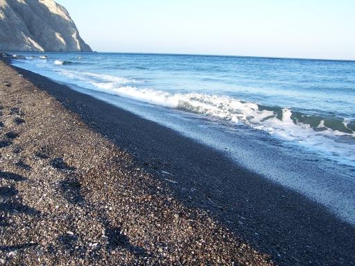 Black sand beach on the Greek island of Santorini. May 2006.