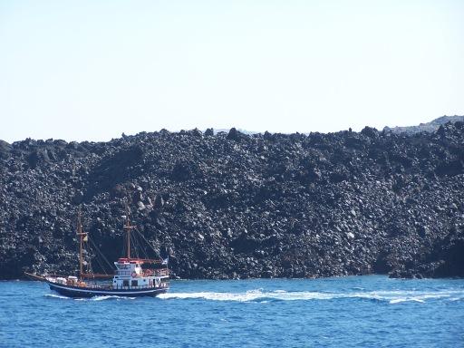 A boat on the Aegean Sea off the coast of Santorini.
