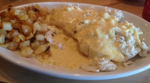 Crab and Eggs Benedict with hashbrowns is delicious.