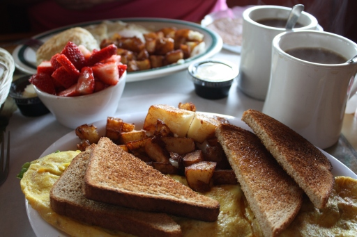 A veggie omelette, home fries, wheat toast, fresh strawberries and coffee for breakfast at Pier House Restaurant in Nags Head, N.C.