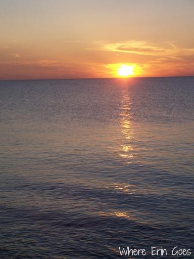The sun sets over Lake Huron in Port Austin, Mich.