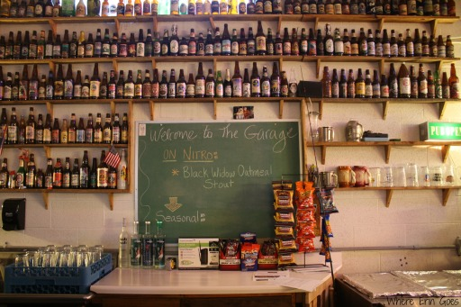 The Yellowstone Valley Brewing Co. garage is outfitted with shelves full of beer bottles from around the world.