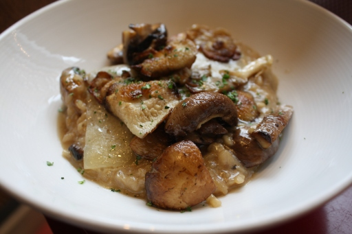Arroz Cremoso De Setas is like a risotto. It's creamy rice with an assortment of mushrooms and melted Spanish sheep's milk cheese.