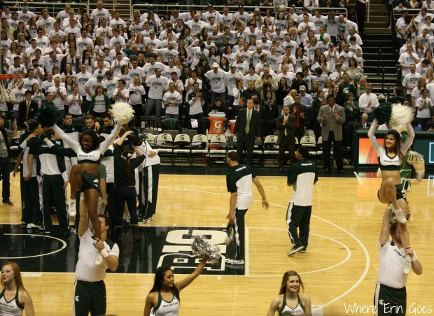 Cheerleaders pump up the crowd as the Michigan State Spartans' starters are introduced on March 1, 2014. (Photo by Erin Klema.)