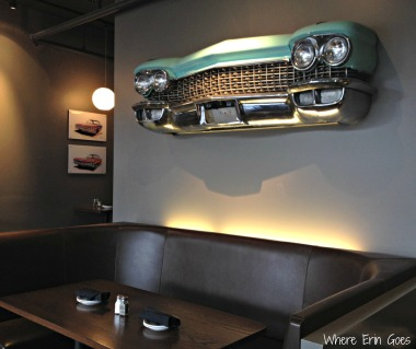 The grille of a classic car hanging above a generously-sized booth greets visitors of this Motor City restaurant. (Photo by Erin Klema)