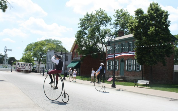 Bicyclists peddle back in time at Greenfield Village. (Photo by Erin Klema)