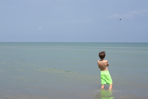 My cousin Jack apparent had enough with skipping rocks into Lake Huron and decided to simply throw this rock instead. (Photo by Erin Klema)