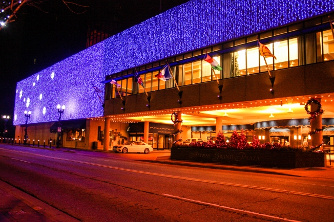 The Amway Grand Plaza Hotel lights up Pearl Street NW in downtown Grand Rapids. (Photo by Erin Klema)