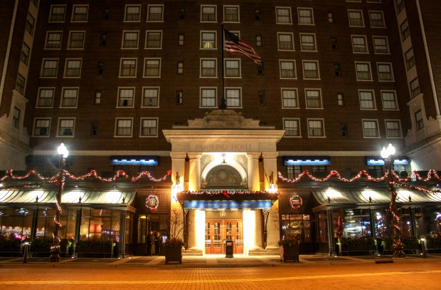 The stately Amway Grand Plaza Hotel is decorated in classic holiday trims -- garland, white lights and red bows. (Photo by Erin Klema)
