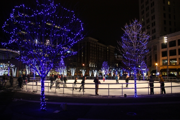 Skaters glide around the outdoor ice rink at Rosa Parks Circle in downtown Grand Rapids on Dec. 17, 2014. (Photo by Erin Klema)
