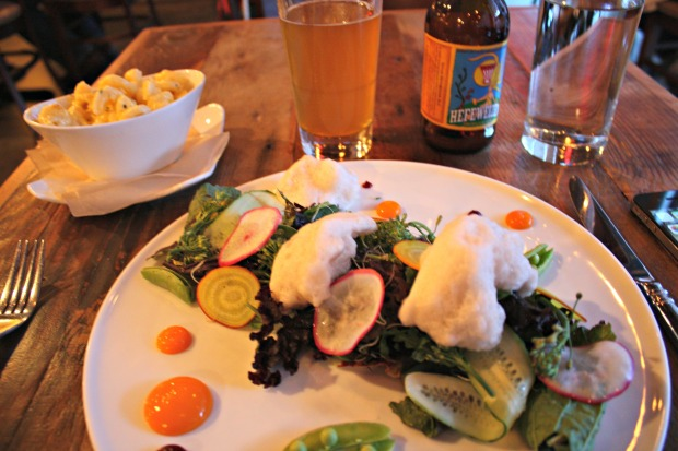 Salad topped with Champagne foam, mac & cheese and a local Nashville hefeweizen at the Farm House in Nashville, Tenn. (Photo by Erin Klema)